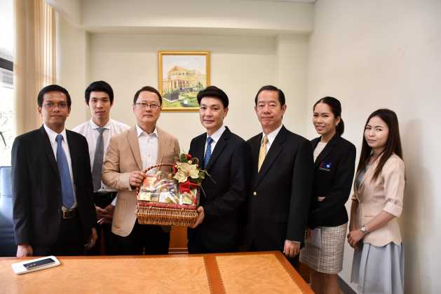 Give gift basket for New Year 2016 to secretary-general of Office of the Public Sector Development Commission and government officers at Office of the Public Sector Development Commission