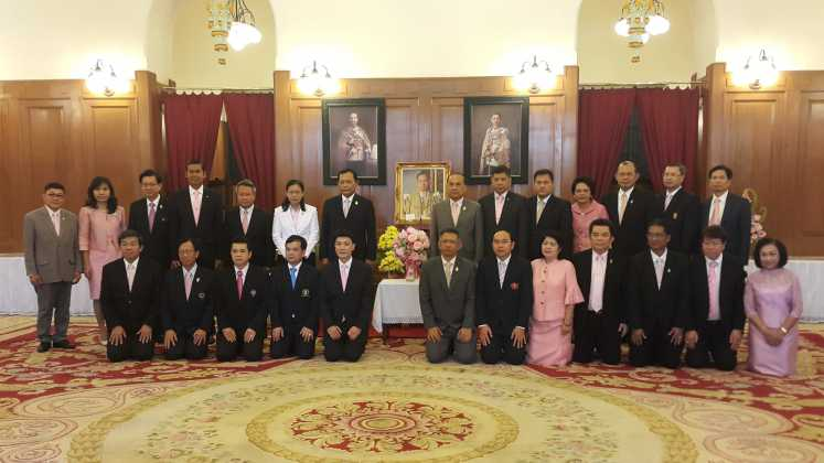 Minister of Ministry of Education and management team sign their names to felicitate His Majesty the King