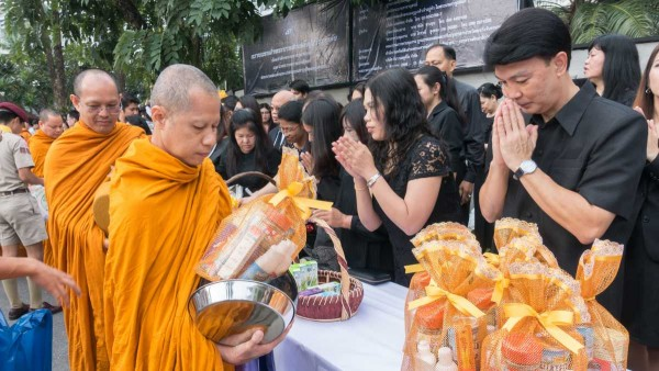 Director of International Institute for Trade and Development (Public Organization) attends in the ceremony of offering alms to the monks on the 15th day after the death of His Majesty King Bhumibol Adulyadej